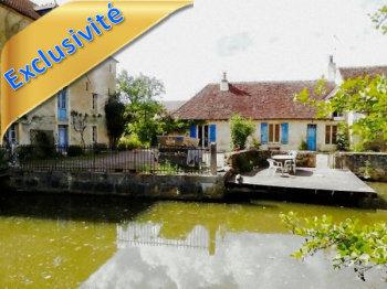 Moulin et sa maison dans un site magnifique
